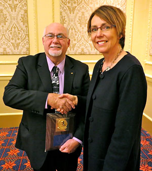 Mike Townsend with Past President Sheryl Bowhay | Dec 2013